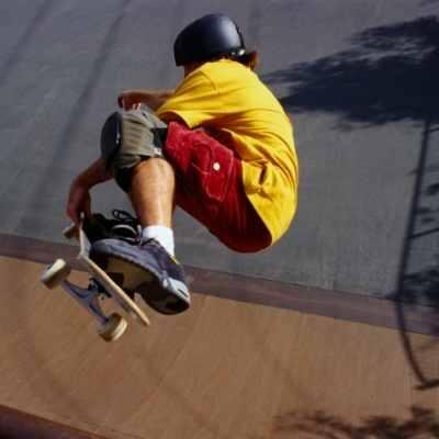 boy yellow shirt skateboarding